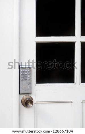 PIN keypad with numbers in the wooden door - stock photo