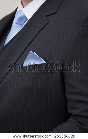 Pin-striped wedding suit with tie and pocket handkerchief - stock photo
