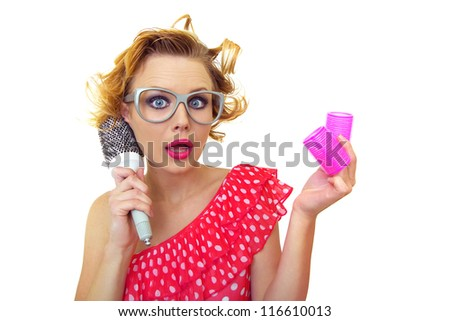 Pin-Up funny girl with hairstyle holding comb and curlers, isolated on white