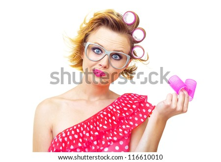 Pin-Up funny girl with hairstyle holding curlers, isolated on white - stock photo