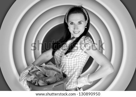 Pin up girl doing laundry. Vintage, retro style black and white photography. - stock photo