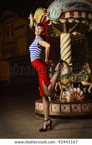 pin up girl in a Parisian style, outside at night, retro stylized photo - stock photo