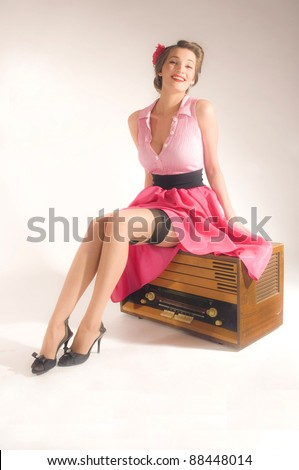 Pin-up girl listen retro radio - stock photo