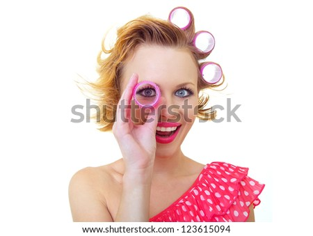 Pin-Up Girl looking thro curlers - stock photo