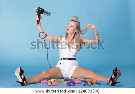 pin up girl retro style portrait woman drying hair with electric fan - stock photo