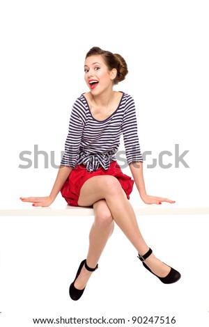Pin-up girl sitting - stock photo