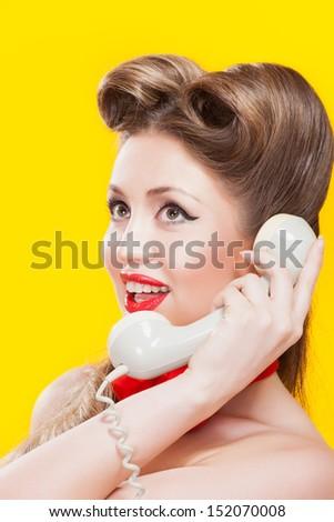 Pin-up girl talking on retro telephone - stock photo