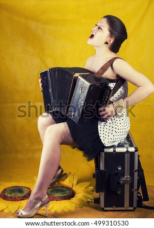 Pin up. Girl with accordion