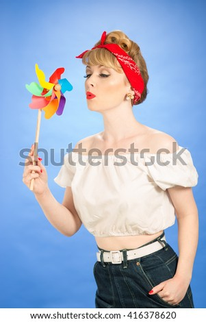 Pin up girl with retro toy windmill