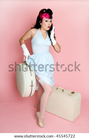 Pin up girl with vintage luggage. - stock photo