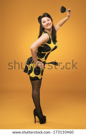 Pin-Up. Housewife in the kitchen. Stockings. Vintage. Retro. - stock photo