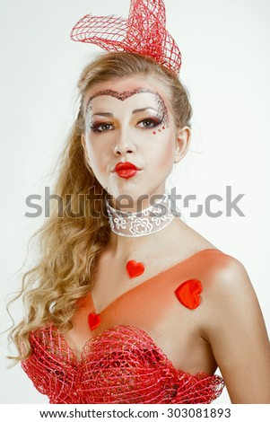pin-up photo of blond young woman. hearts over white