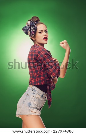 Pin up pose inspired by classic american poster - We can do it - stock photo