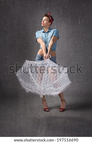 pin up pose with white umbrella - stock photo