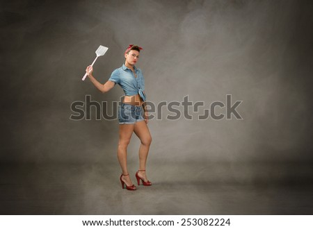 pin up with mosquito slayer on hand - stock photo