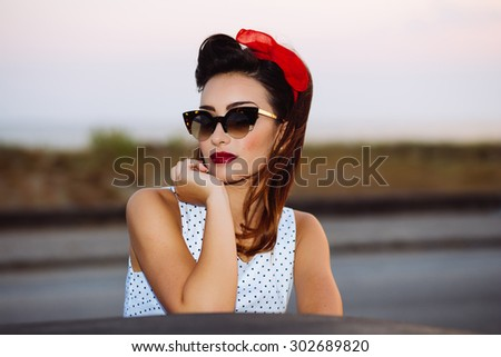 Pin-up with sunglasses  - stock photo