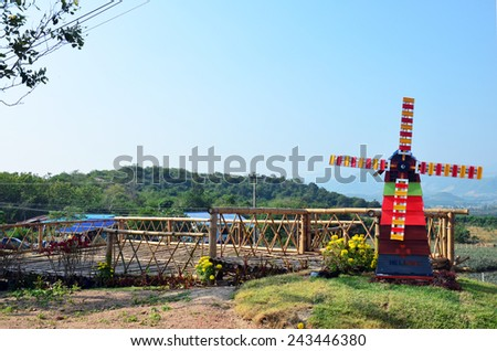 Pin wheel or windmill on Viewpoint in winter season at Ban Kha is a district in the western part of Ratchaburi Province, central Thailand. - stock photo