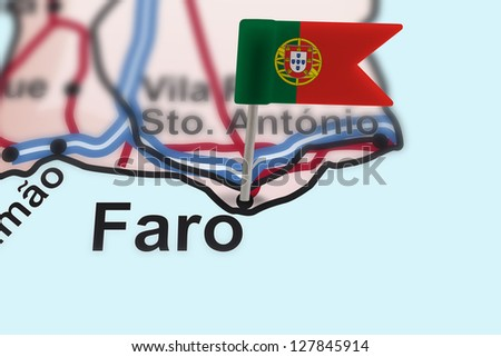 pin with flag of Portugal in Faro with selective focus - stock photo