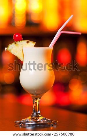 Pina Colada cocktail on a bar counter - stock photo