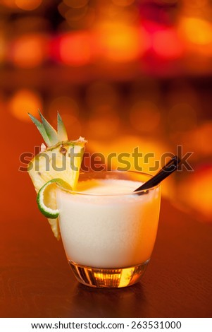 Pina Colada cocktail on a bar counter in a nightclub - stock photo
