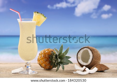 Pina Colada cocktail with fruits on the beach while on vacation - stock photo