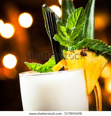 Pina colada detail in a night pub. - stock photo