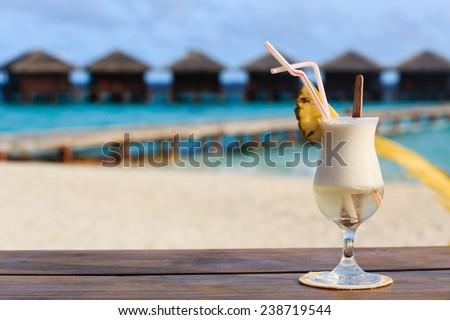 pina colada on tropical beach resort - stock photo