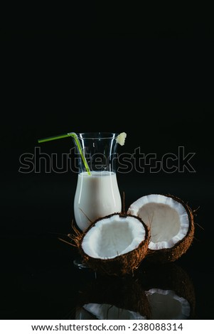 Pina Colada over black background, with coconut. - stock photo