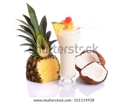 Pina Colada over white background, garnished with slice of pineapple and coconut.