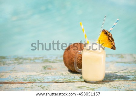 Pinacolada drink in cocktail jam on the beach