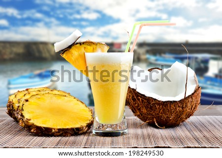 Pinacolada pina colada cocktail with beach background