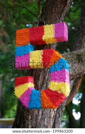 Pinata as numbers of five for child birth - stock photo