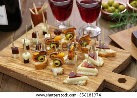 pinchos, tapas, spanish canapes, party finger food - stock photo