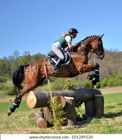 PINCINA, SLOVAKIA APRIL 28: Unidentified rider competes at the International Eventing Championship Spring Military on April 28, 2012 in Pincina, Slovakia - stock photo