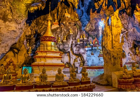 PINDAYA, MYANMAR - FEBRUARY 27, 2013: These caves are Buddhist shrines where thousands of Buddha images have been consecrated for worship over the centuries. - stock photo