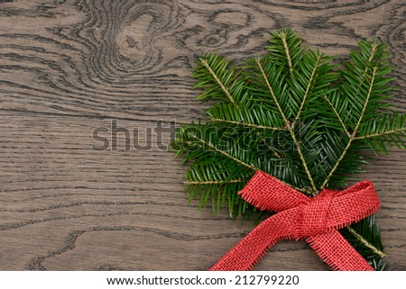 pine branch lying on wood - stock photo