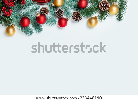 Pine branch with christmas toy on white background.