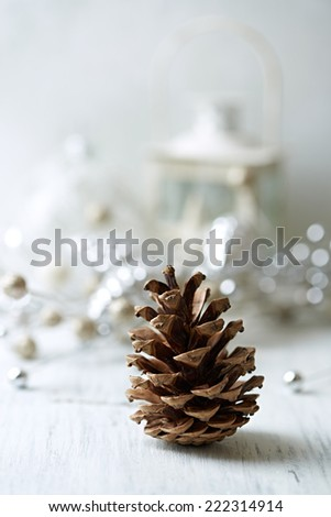 Pine cone and Christmas decorations - stock photo