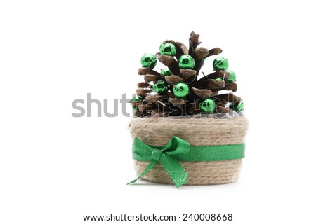 pine cone decorated as a Christmas tree