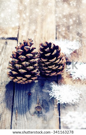 Pine cones on old wooden background in vintage style - stock photo