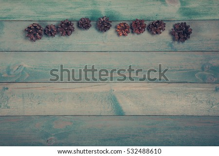 Pine cones on old wooden background with copy space. Top view