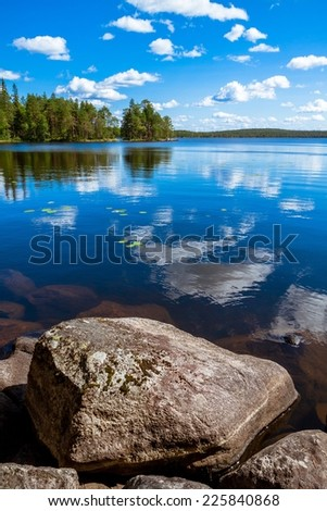 pine forest reflection in the lake in the Salamajarvi National Park, Finland - stock photo