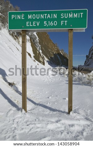 Pine Mountain Summit elevation sign after fresh snowfall along Highway 33 north of Ojai, California - stock photo