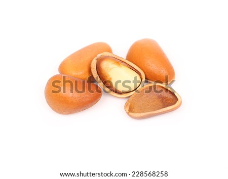pine nuts on white background
