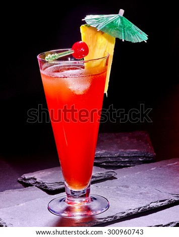 Pineapple cocktail with cherry and umbrella  in highball glass . Cocktail card 79