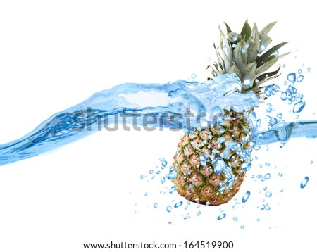 Pineapple dropped into water - stock photo