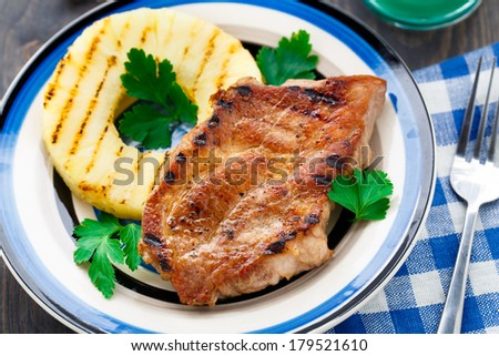 Pineapple grilled pork chop - stock photo