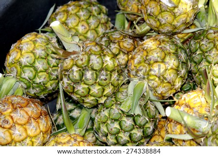 Pineapple in the market - stock photo