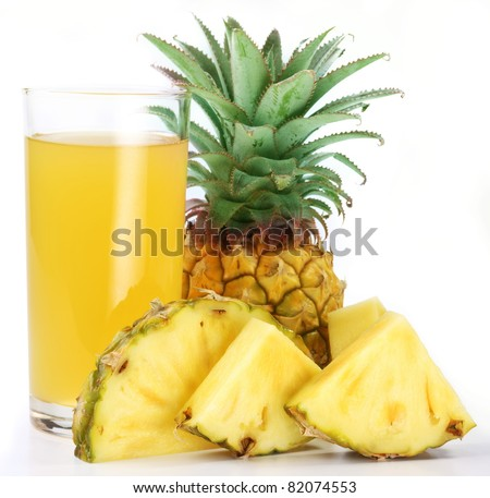 Pineapple juice in a glass of pineapple slices. Image on white background. - stock photo