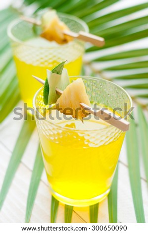 pineapple juice isolated on white - stock photo